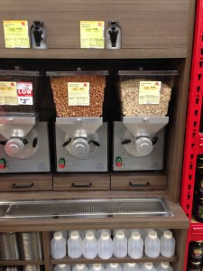 The bulk dispensers dispense not only granolas, but also things like peanut butter (top).